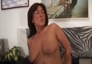 Busty brunette enjoys her son's hard dick