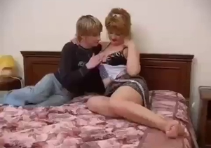Young son licks his mom's shaved pussy with love
